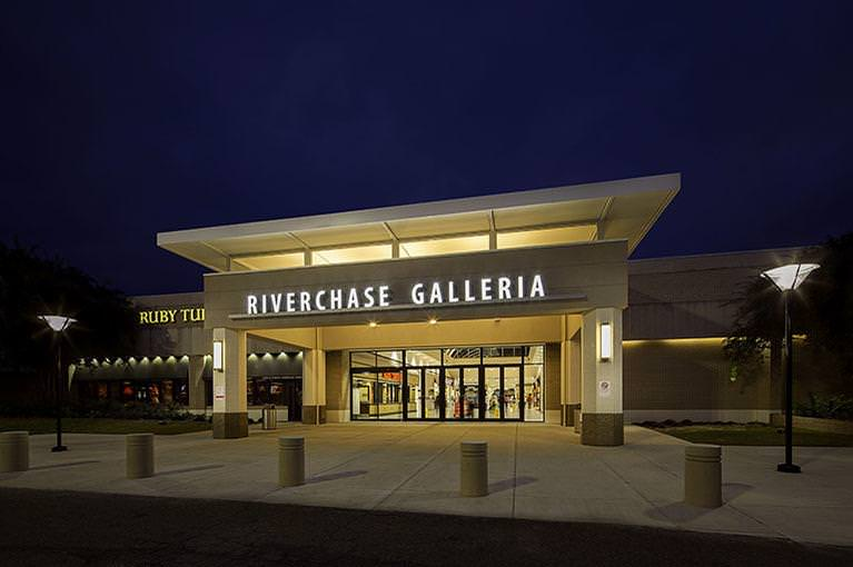Next to Ruby Tuesday, an exterior entrance to Riverchase Galleria is alight at dusk.